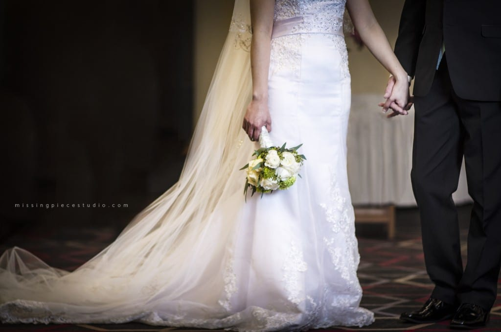 Four Points by Sheraton Edmonton South Wedding Photography Photographer Ceremony Venue-holding hands