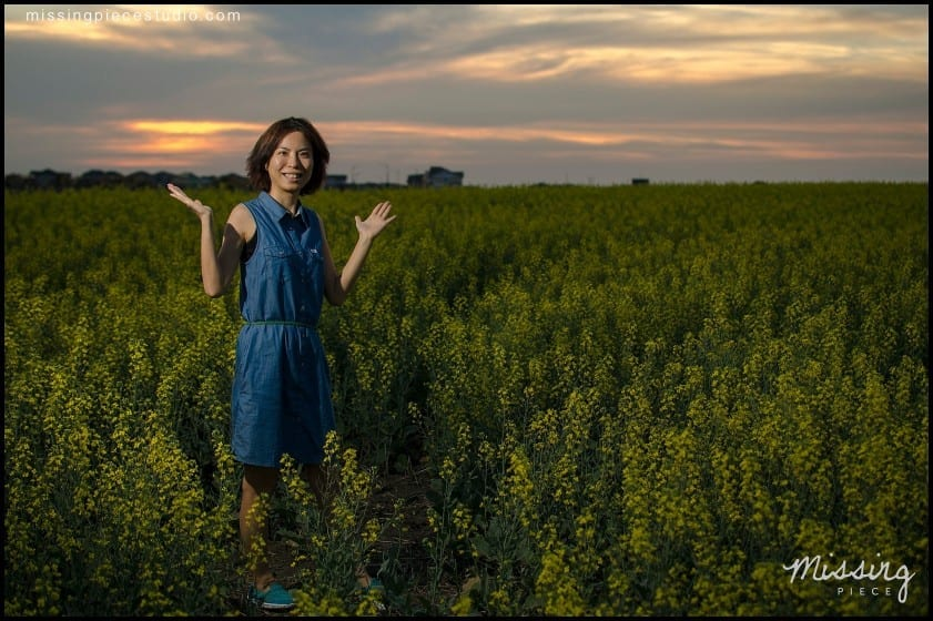My cousin posing in a beautiful canola field during sunset.