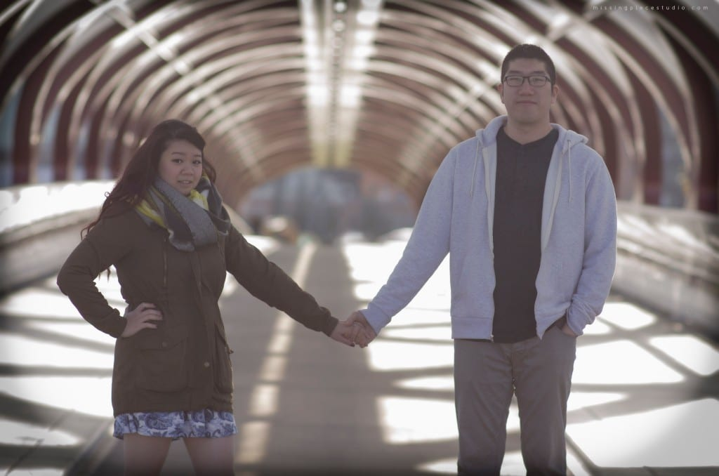 A couple being photographed at the peace bridge in Calgary YYC Canada