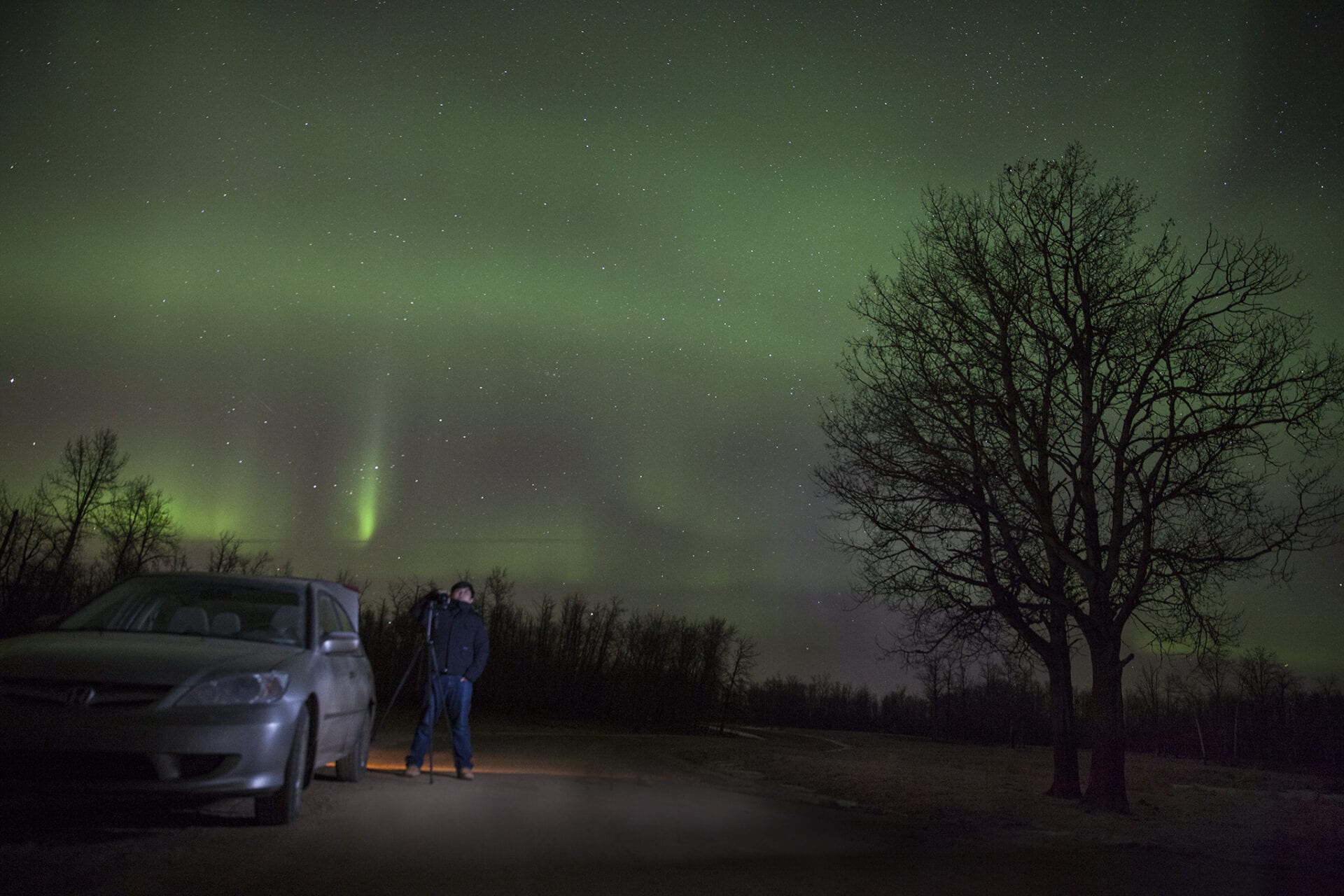 Edmonton Photographer Shooting under the Northern Lights with a car Honda Civic